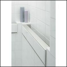 Belay In-Tile Handrail by Kohler provides the safety and security of a shower grab bar without looking like it is a grab bar. The focus is on the beautiful tiling in the shower rather than on the assistive device.
