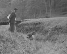 1954: Amateur Billy Joe Patton retrieves his ball from a tributary of Rae's Creek at No. 13. He made double bogey and missed a playoff by one shot    http://www.Augusta.com Golf