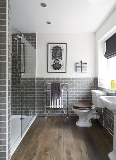 Grey and White ensuite, grey metro tiles, dark oak flooring, Heritage sinks, toilet, and shower.
