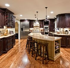 Love the dark wood and curved layout.