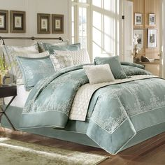 Refresh your master suite or guest room with this elegant comforter set, showcasing a soft blue hue and scrolling jacquard details.