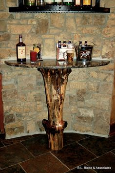 A great side table that is both efficient and beautifully western!  Perfect for any bar. (Home Design & Decor by B.L. Rieke & Associates, Inc.)  #naturalstone #bar #westernhome #granite #log #dreamhome #customhome #homedesign Visit our website: http://www.blrieke.com/ Visit our #Houzz page: http://www.houzz.com/pro/blrieke/