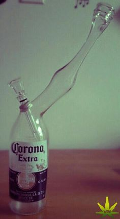Looks like this bottle got heated up and stretched then made into a bong...pretty wicked stuff..