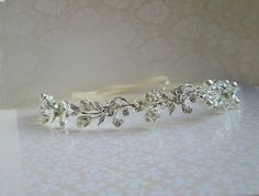 Check out this item in my Etsy shop https://www.etsy.com/listing/230973349/bridal-hairpiece-crystal-silver-wedding
