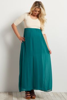 A night out calls for the most gorgeous maternity maxi dress in your closet. This chiffon bottom color block number is designed just for this occasion. A breezy style and flattering cut gives you a comfortable feel that you know will make you look amazing all night long.