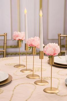 Simple and elegant, these gold taper candle holders make pretty wedding candle displays, mantel decor, and more. Find affordable decor at ConsumerCrafts.