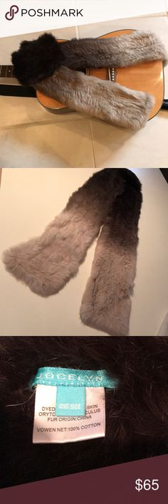 Genuine rabbit fur scarf. Full skin dyed rabbit skin scarf.  Both sides are rabbit.  It ha an ombré look going from darker brown to lighter brown and then a tan-like color.  Why not be warm and fashionable on those chilly days! Jocelyn Accessories Scarves & Wraps