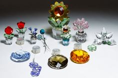 Lot 277: Swarovski Crystal Flower Figurine Assortment; Nine pieces; together with sun catchers and balloons; all are marked