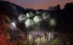 Artist Javier Riera projects beams of light onto various landscapes, creating installations that explore the link between nature and geometry.