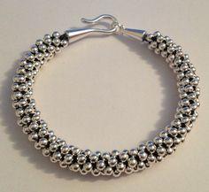 Silver beaded Kumihimo bracelet by Jewellery by Janine https://www.facebook.com/JewelleryByJanine
