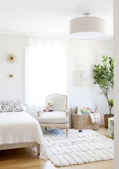 Bright and neutral children's room with reading corner and indoor plant