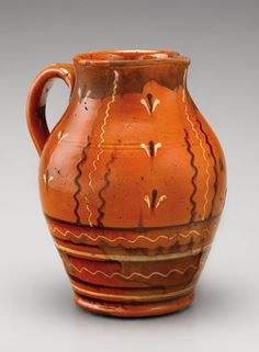 "Pitcher, Alamance County, North Carolina, 1800-1835. Lead-glazed earthenware. H. 10"". (Private collection.) --- Art in Clay: Masterworks of North Carolina Earthenware by Old Salem Museums and Gardens, Chipstone Foundation, and Caxambas Foundation."