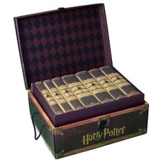 """Complete set of Harry Potter Books """"wrapped"""" in Hufflepuff, Ravenclaw, Slytherin or Gryffindor and sent in a trunk. WANT."""