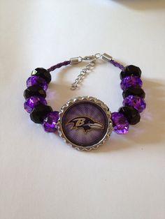 "Baltimore Ravens Football Inspired Beaded Purple Leather Adjustable Bracelet w Ravens Girl Pendant w purple white background 7 1/2""-9"" on Etsy, $20.00"