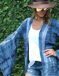 Add a boho flare to your ensemble with our Runway Vagabond Alanis Tie Dye Duster/Cardigan in this blue and white tie dye effect from ShopSwank.com!
