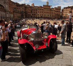 A Mercedes-Benz SS, built in 1928, at the Mille Miglia 2013; the spectators are right up close.