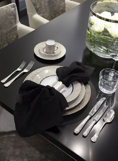 silver napkin rings and simple, stylish way to display a napkin/place setting - Fiona Barratt Interiors