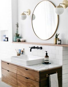 "Meuble évier ""buffet"" et marbre // great bathroom details, round mirror, modern wall sconces"