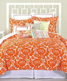 orange comforter to go with our blue carpet and walls!