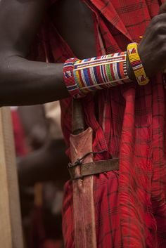 Africa | Details; young Maasai warrior dressed in traditional clothing and beaded jewellery.  Amboseli National Park, Kenya | ©Beverly Joubert.