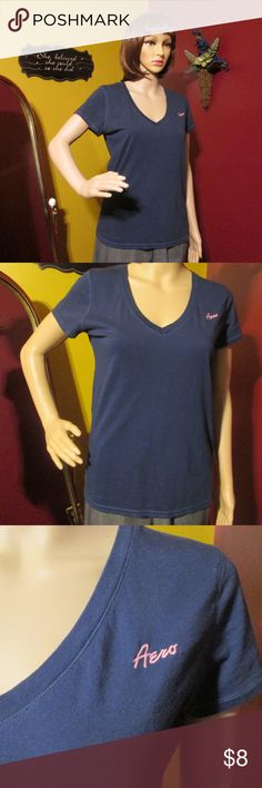 Aeropostale V Neck Tee Shirt Womens Medium Blue Aeropostale V neck Tee Shirt Womens, very soft material.  Color: Medium Blue with pink writing Aero  Size: XL  Aeropostale letters inside the shirt are coming loose  100% Cotton  Bundle 2 or more items together for a discount of 10% at least.  Thanks for visiting my closet! Come back soon. Happy Poshing!! Aeropostale Tops Tees - Short Sleeve