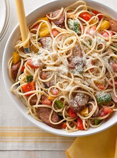 Chicken Sausage, Peppers & Tomatoes with Linguine — Grandma may not be ready to reveal her sausage-and-peppers recipe, so make this version instead—a simple yet bold twist on the classic pasta dish.
