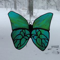 Butterfly stained glass suncatcher by GlassbyGeldner on Etsy, $25.00
