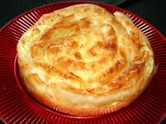 Banitsa is a traditional Bulgarian recipe that consists of eggs and cheese between filo pastry sheets formed in a spiral before baking.
