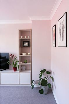 Refurbished living room. Pink walls. Pale pink. Pink and grey. Translucent white plywood. Plywood storage.
