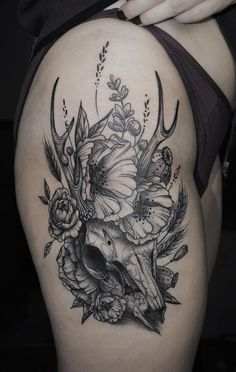Deer skull with flowers by Kati Berinkey.