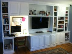 Custom Built in shelving with mounted TV and Desk!