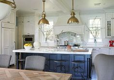 This kitchen by Mary McDonald features a pair of Large Country Industrial Pendants and a Modern Globe Pendant over the breakfast table