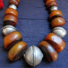 Hey, I found this really awesome Etsy listing at https://www.etsy.com/listing/183806848/berber-amber-resin-old-silver-beads