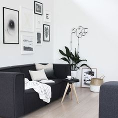 Monochrome living room with a gallery wall