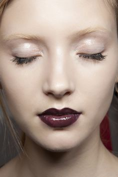The relative bareness of the face around the vampy lip, except for the heavy mascara and slight shimmer/gloss on the eyes makes this look both easy to wear and also very striking.