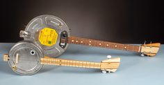 Cookie tin banjo and film canister ukuleles and banjos ~ Way cool.