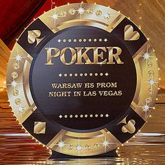Our Las Vegas Giant Poker Chip has the look of a black poker chip with gold and diamond accents, outlined in white lights.