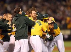 Coco Crisp is congratulated by the A's after hitting the game-winning sacrifice fly. He homered to lead off the game. Photo: Ezra Shaw, Getty Images / SF