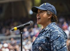 Hospital Corpsman 3rd Class Grace Layugan, representing the aircraft carrier USS Theodore Roosevelt (CVN 71), performs the national anthem on the field at Petco Park, home field of the San Diego Padres during Petco Park's Theodore Roosevelt Day.