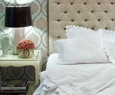 diggin the wallpaper and tufted headboard