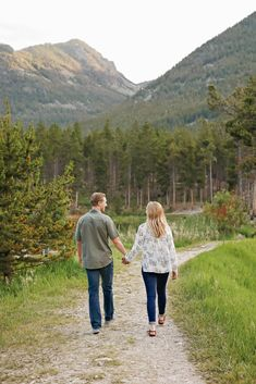 Summer Engagement Session - Red Lodge - Mountains - Trees - Sunset - Holding Hands - Walking - Path - Fiance - Engaged Couple - Green Shirt - Olive Shirt - White Floral Shirt - Jeans - Montana Wedding Photographer - Sara Nagel Photography Engagement Couple, Engagement Session, Engagement Photos, Red Lodge Mountain, Olive Shirt, Montana Wedding, Walking Paths, How To Pose, Green Shirt