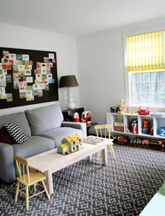 playroom/office area. Perfect use for the huge bulletin board in my basement, cover in an awesome fabric and use to pin up cards!