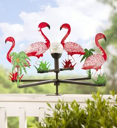 Our wind spinners, whirligigs and garden spinners bring incredible movement to your outdoor d�cor. Shop metal wind spinners, copper wind spinners and more. Wind Spinners, Garden Spinners, Flamingo Garden, Flamingo Decor, Pink Flamingos, Flamboyant, Pink Bird, Garden Statues, Coastal Decor