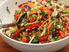 Asian Slaw with Ginger-Peanut Dressing  For the Dressing  ¼ cup honey ¼ cup vegetable oil  ¼ cup unseasoned rice vinegar* 1T soy sauce 1t Asian sesame oil 1T peanut butter ½t salt ½t Sriracha sauce (Thai hot sauce…optional) 1T minced fresh ginger  1 large garlic clove, minced    For the Slaw  4 cups prepared shredded coleslaw  2 cups prepared shredded c...