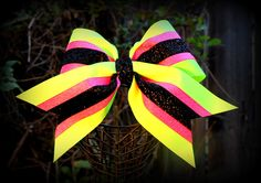 Hand crafted cheer bow in neon lime green base hot pink glitter grosgrain center black glitter velvet center. See more on Facebook at  Ribbons and Bows Oh My  or our website at www.ribbonsandbowsohmy.net.   For custom design work email us at  ribbonsandbowsohmy.net@gmail.com