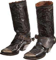 heckyesamericana:  ca. 1890's, [hand-tooled leather cowboy boots  with a floral motif, etched silver mounts and steel spurs] via Heritage Auctions
