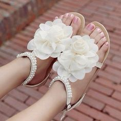 flat sandals with beads and flower for a beach wedding