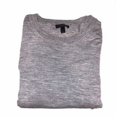 JCREW merino wool sweater Grey crewneck wool sweater. Ribbed at neck, cuffs and hem. 3/4 sleeves. Slight pulling seen at hem-seen in picture & reflected in price. Fits M/L. J. Crew Sweaters Crew & Scoop Necks
