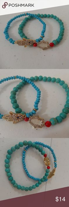 Hamsa Hand or Hand of Fatima Bracelets Set of two gorgeous beaded bracelets. Beads of blue and aqua with gold highlights. One features the Hamsa Hand or Hand of Fatima. The Hamsa Hand is an ancient Middle Eastern amulet symbolizing the Hand of God. In all faiths it is a protective sign. It brings its owner happiness, luck, health, and good fortune. The hamsa hand has a wide variety of different spellings which includes hamesh, hamsa, chamsa, and khamsa. Stretch bracelets, Beautiful…