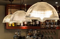 Our beautiful George LED filament lattice globe light bulbs inside glass shade pendants at GBK.